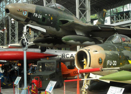 Some of the many jet fighters displayed at the Royal Armed Forces Museum in Brussels. In front an American built F-86 Sabre and on top an American built F-84 Thunderflash.