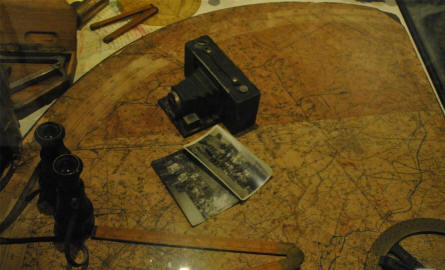 World War I map and camera displayed at the In Flanders Fields Museum in Ypres.