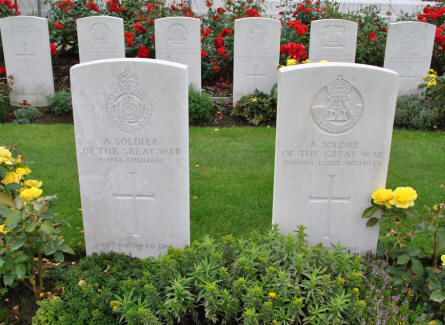 "Two of the many graves of ""unknown"" soldiers at the Tyne Cot War Cemetery near Zonnebeke."