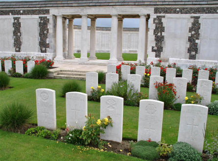 Some of the graves in from of the memorial wall at the Tyne Cot War Cemetery near Zonnebeke. The wall contains thousands of names.