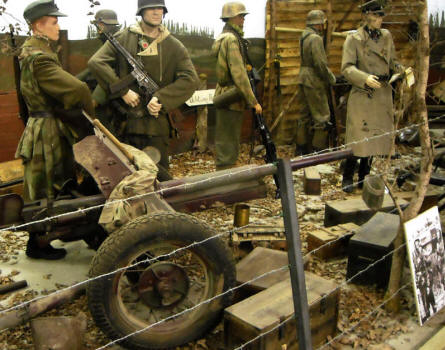 German World War II soldiers and an anti-tank gun displayed at the Museum Poteau '44 Ardennes.