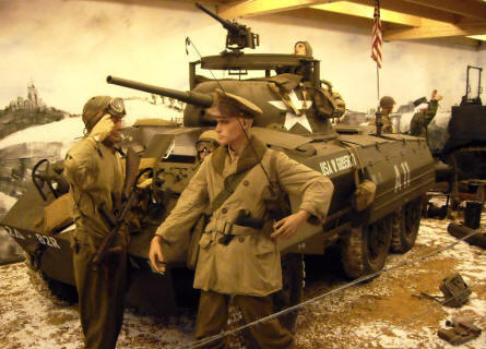 American World War II soldiers in front of a M8 Greyhoud armoured car at Museum Poteau '44 Ardennes.