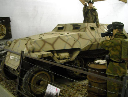 A German World War II Sdkfz 251half-track displayed at the Museum Poteau '44 Ardennes. Notice the German soldier with the camera at the right.