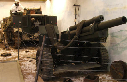 An American World War II canon and tracked gun tractor displayed at the Museum Poteau '44 Ardennes.