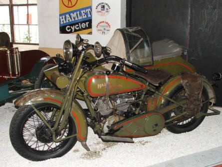 A vintage Harley-Davidson motorcycle with sidecar displayed at Egeskov Castle.