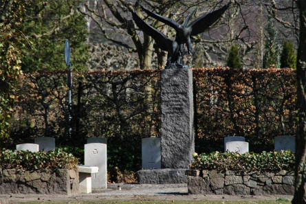 The memorial in the centre of the RAF War Graves at Odense Assistens Cemetery has two eagles at the top.