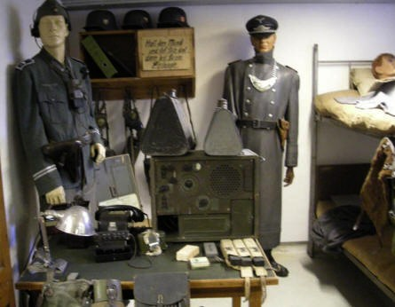German World War II uniforms and equipment displayed at the Aarhus Occupation Museum.