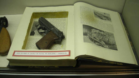 A World War II pistol hidden in a book by a member of the Danish resistance movement - displayed at the Aarhus Occupation Museum.