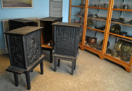 A number of vintage stoves and metal products displayed at the Herning Museum.