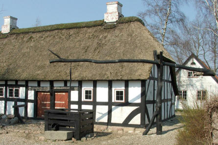 A typical house and well at Glud Open-air Museum.