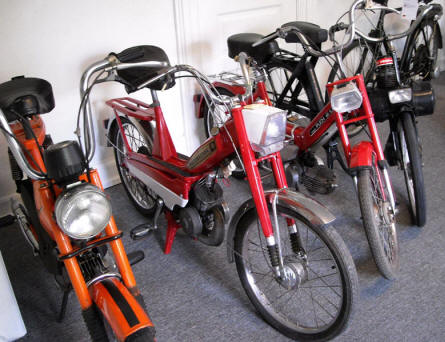 Some of the mopeds that are displayed at Denmark's Bicycle Museum.