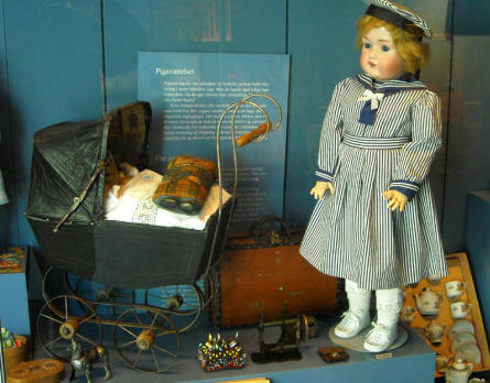A vintage doll displayed as a part of the toys collection at Holstebro Museum.