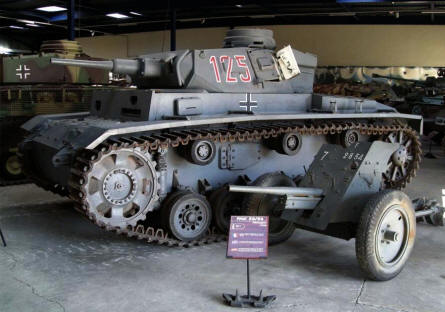 A German World War II Sd.Kfz.141 Panzer III tank and a PAK-35/36 anti-tank gun displayed at Saumur Tank Museum (Musée des Blindés).