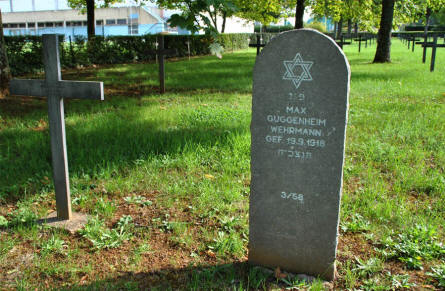 Two of the many German World War I graves at the Briey German War Cemetery. A Christian cross and a Jewish gravestone.