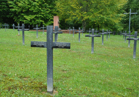 Some of the many German World War I graves at the Épinonville German War Cemetery. The grave in the front is for soldiers that were killed in 1917.