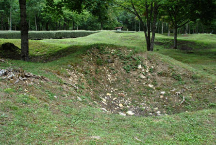 One of the many large bomb craters at the Destroyed village of Fleury-devant-Douaumont.