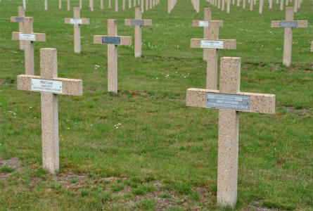 Some of the many French World War I & II graves at the Verdun-Bevaux French Cemetery in Verdun. The solider in front (right) was killed in 1916.