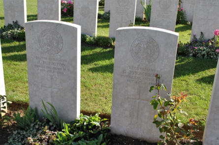 The World War I graves of a Serjeant and a Lieutenant (both killed on the 1st of July 1916) at the Bapaume Post Military Cemetery just east of Albert.