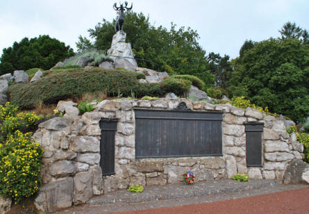 The central memorial mound at the Beaumont-Hamel Newfoundland Memorial. On the mound, surrounded by rock and shrubs native to Newfoundland, there stands a great bronze caribou, the emblem of the Newfoundland Regiment.
