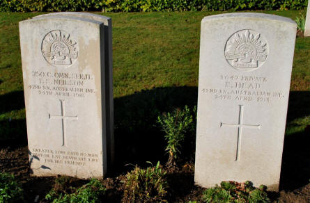 The World War I graves of Sergeant F. S. Neilson and Private E. Head (both killed on the 24th of April 1918) at the Bonnay Communal Cemetery Extension.