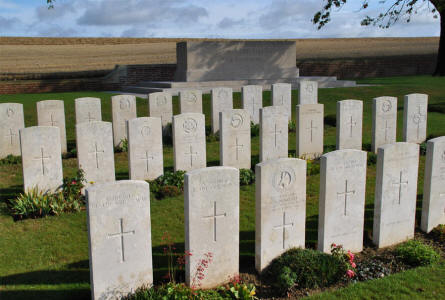 Some of the many World War I graves at the Ovillers Military Cemetery just east of Albert. It the background the central memorial stone.