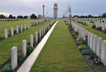 A small section of World War I war graves at the Villers-Bretonneux Military Cemetery (Amien). In the background the Villers-Bretonneux Memorial Tower and the Australian National Memorial.
