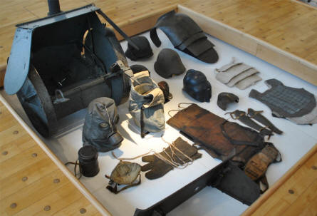 Some of the special World War I protective equipment displayed at the Museum of the Great War 1914-1918 in Péronne. Armoured vests, gas masks, barbed wire glows etc.