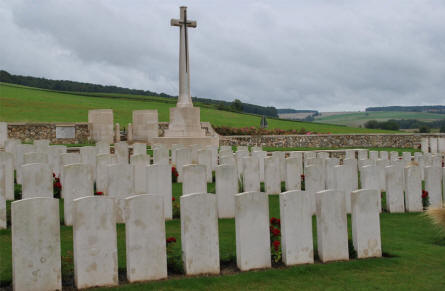 Some of the many World War I graves at the Chambrecy British Cemetery seen from the cemetery towards the road. The Cross of Sacrifice is just inside the entrance.