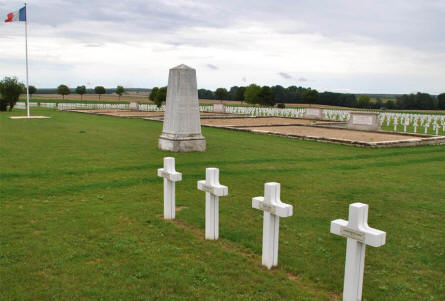 "The large graves of the ""unknown soldiers"" and one of the memorial stones at the Souain French National War Cemetery."