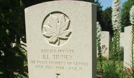 The grave of Private B.L.. Tinny - killed on the 17th of July 1944 (18 years old) - at Beny-Sur-Mer Canadian War Cemetery in Reviers.