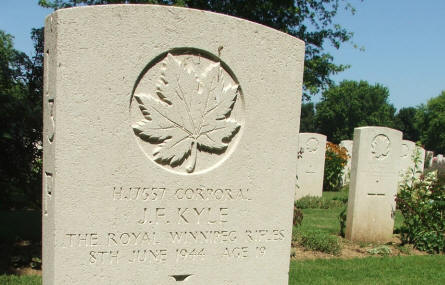 The grave of Corporal J.F. Kyle - killed on the 8th of June 1944 (19 years old) - at Beny-Sur-Mer Canadian War Graves in Reviers.