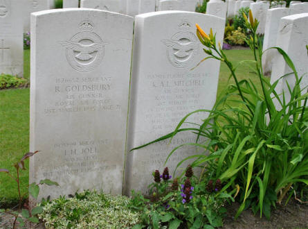 The graves of a World War II Royal Air Force crew at the Hamburg War Cemetery. Notice that there are two names on both stones.