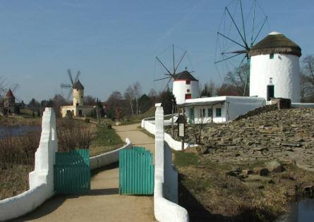 A number of traditional South European windmill at the International Wind - & Watermill museum in Gifhorn.
