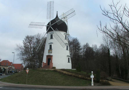 A windmill outside the International Wind - & Watermill museum in Gifhorn.