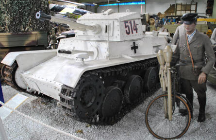 A small German World War II tank in winter paint displayed at the Sinsheim Technical Museum.