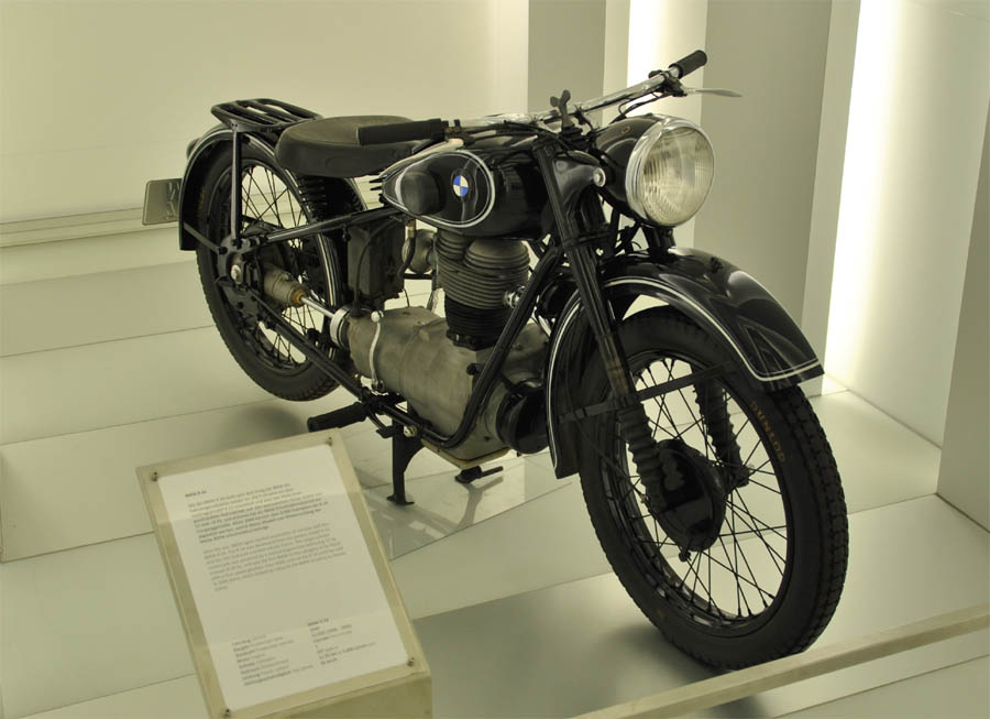 a classic 1930's bmw r24 motorcycle displayed at the bmw museum in