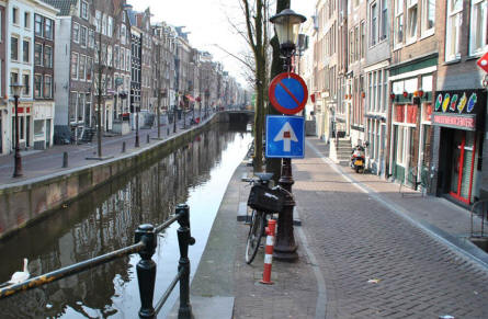One of the many canals - with the typical narrow streets - in the centre of Amsterdam.