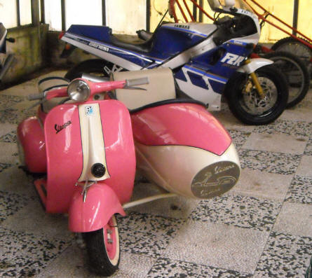 A vintage Vespa scooter displayed at the Museum Gottard Park.