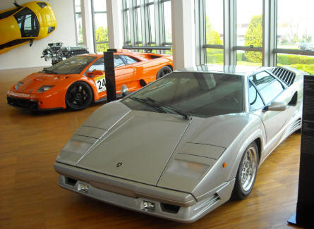 Some of the many Lamborghini sports cars that are displayed at the Lamborghini museum in Sant'Agata Bolognese. In front a Lamborghini Countach 25th edition.