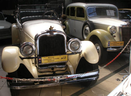A vintage Oakland and Mercedes displayed at the Motorisation Museum at in Otrębusy.