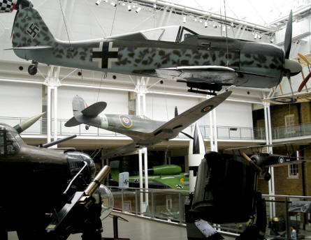The main hall at the Imperial War Museum in London. With rocket, search lights, FW-190, Spitfire, He-162 and much more.
