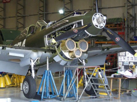 A World War II Curtis P-40 is being restored in all details at Duxford.